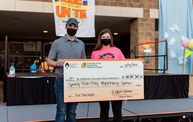Liqui-Grow presents sponsorship check to SAU Dance Marathon Sponsorship Director Heather Hoeger.