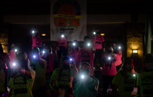 The Executive Board and Morale finish the Morale Dance with flashlights.