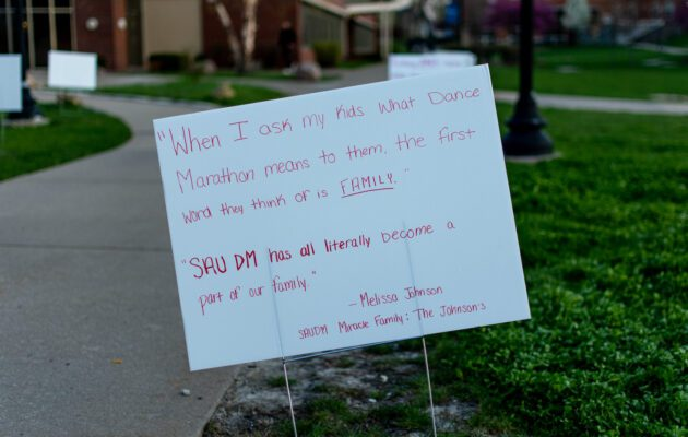 Signs around the Rogalski Center Lawn read DM quotes.