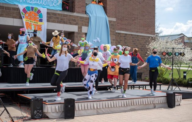 Morale performs the Morale Dance in Toy Story outfits.