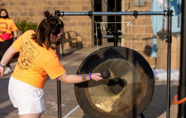 Dancers ring the gong after every $50 donation they receive throughout the day.